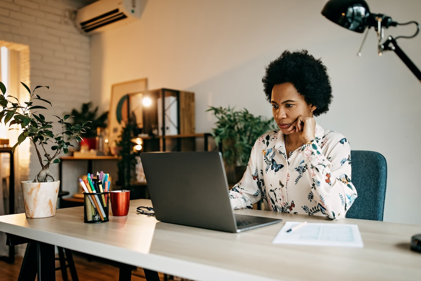 woman sitting at home office desk